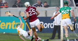 Jason Flynn scores one of Galway's five goals against Offaly. Photograph: Bryan Keane/Inpho