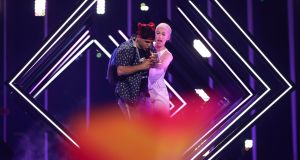 A fan invades the stage during the performance of SuRie (right) for  the UK at the Eurovision Song Contest  final at the Altice Arena in Lisbon, Portugal. Photograph: Jose Sena Goulao/EPA