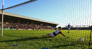 Donie Kingston of Laois scores his  penalty. Photograph: Ken Sutton/Inpho