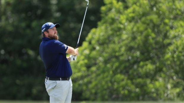 Simpson ties course record, leads by five