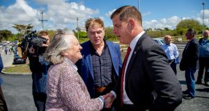 Mayor of Boston Marty Walsh (right) is welcomed to the new Emigrant Commemorative Centre, in Carna in Connemara  by Mary Cosgrave and Mairtín Ó Catháin, centre, chairman of the centre's organising committee. Photograph:  Sean Ó Mainnín