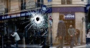A bullet hole in the window of a cafe located near the area where a knife attacker was shot dead by police officers in central Paris on Saturday. Photograph: Thibault Camus/AP Photo
