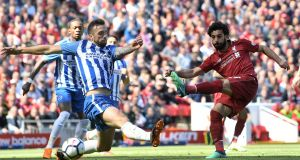 Mohamed Salah scores Liverpool's opener against Brighton. Photograph: Michael Regan/Getty