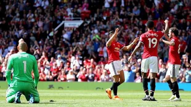 Marcus Rashford celebrates opening the scoring for Manchester United. Photograph: Matthew Lewis/Getty