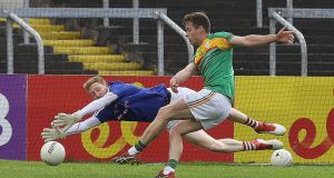 Carlow's Paul Broderick scores a goal in the win over Louth. Photograph: Lorraine O'Sullivan/Inpho