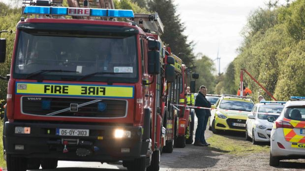 Emergency services at the scene of the crash of a light aircraft near Clonbullogue, Co Offaly, on Sunday. Photograph: Eamonn Farrell/RollingNews.ie