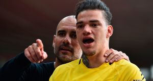 Manchester City's  manager Pep Guardiola with his goalkeeper Ederson after the match at St Mary's Stadium. Photograph: Getty Images