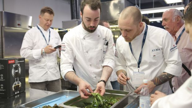 The UK and Ireland finalist, Killian Crowley, second left, preparing his dish for the final judging