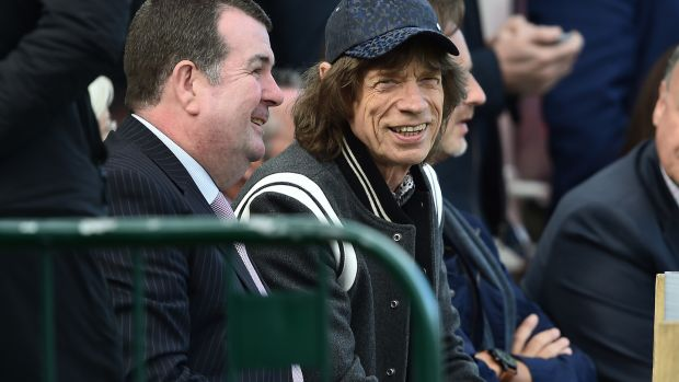 Mick Jagger watches play during the third day of the test cricket match between Ireland and Pakistan on Sunday in Malahide. Photograph: Charles McQuillan/Getty Images