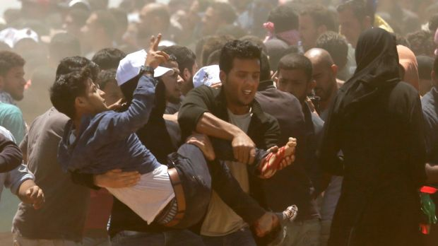 Palestinians carry a demonstrator injured during clashes with Israeli forces near the border between the Gaza strip and Israel east of Gaza City on Monday. Photograph: Mahmud Hams/AFP/Getty Images
