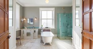 The large bathroom boasts a standalone bath.