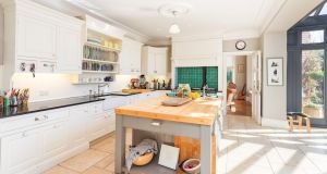 Ulverton's kitchen features an Aga, Belfast sink and flagstones underfoot.