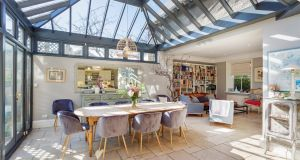 There is a second conservatory in the dining area of the kitchen flooding the room with light.