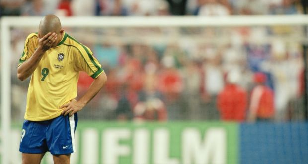4cef7e9e1 Ronaldo stands dejected after Brazil lost to France in the 1998 World Cup  final. Photo