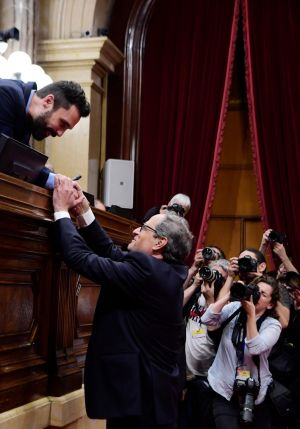 CATALAN CONGRATS: Newly elected Catalan regional president Quim Torra (bottom) is congratulated by the Catalan parliament's speaker Roger Torrent after a voting session at the parliament in Barcelona. Quim Torra is a newcomer to politics who has long campaigned for independence in Catalonia. Photograph: Lluis Gene/AFP/Getty Images