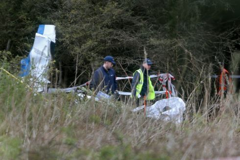 LIGHT PLANE CRASH: Gardaí and Air Accident Investigation Unit personnel examine the wreckage of an aircraft which crashed in boggy woodland on the outskirts of Clonbullogue, Co Offaly, killing the pitot and a boy aged 7. Photograph: Colin Keegan/Collins Dublin
