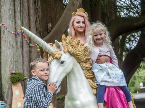 FAIRYTALE FESTIVAL: Katie Doyle (5) and her brother Sean (8), from Inistioge, joins Sleeping Beauty and a unicorn during the launch of the third annual Fairytale Festival at Woodstock Gardens in Inistioge, Co Kilkenny, to take place on Sunday, July 22nd. Photograph: Pat Moore