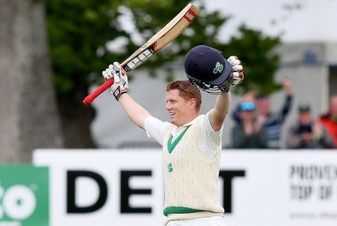 CELEBRATING THE CENTURY: Ireland's Kevin O'Brien celebrates his century during play on day four of Ireland's inaugural test match against Pakistan at Malahide cricket club, Dublin. Photograph: Paul Faith/AFP/Getty Images