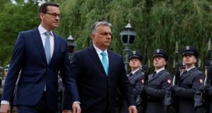"Poland's prime minister Mateusz Morawiecki meets his Hungarian counterpart Viktor Orban in Warsaw on May 14th: they have ""absolutely identical"" views on the need to safeguard farm subsidies and development funds for poorer members. Photograph: Kacper Pempel"