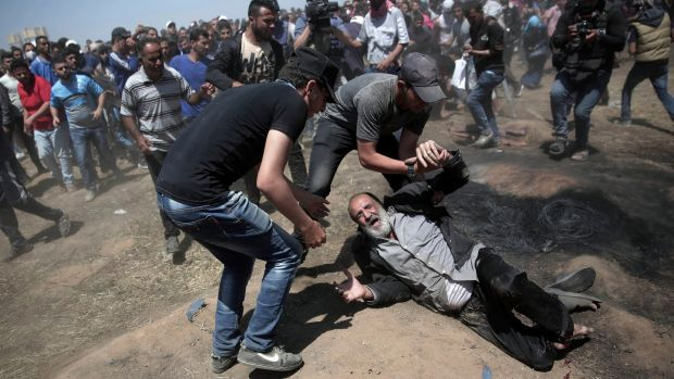 An elderly Palestinian after being shot by Israeli troops during a deadly protest at the Gaza Strip's border with Israel, east of Khan Younis, Gaza Strip. Photograph: Adel Hana/AP