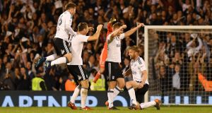 Oliver Norwood  and Ryan Sessegnon of Fulham celebrate with team mates at the final whistle of their  Championship playoff semi-final, second leg match against Derby County at Craven Cottage on Monday evening. Photograph by Mike Hewitt/Getty Images