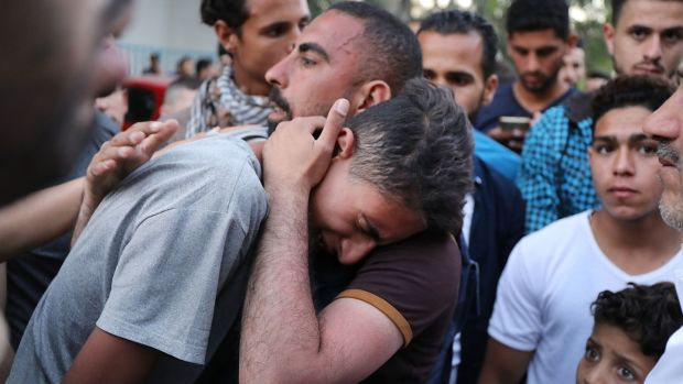 A teenager cries as he learns that his brother was killed on Monday during protests at the border fence with Israel in Gaza. Photograph: Spencer Platt/Getty Images