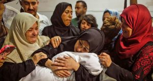 The mother of a Leila al-Ghandour, a Palestinian baby of eight months who, according to the Palestinian health ministry,   died of tear gas inhalation during violence at the Gaza border on Monday, holds her at the morgue of al-Shifa hospital in Gaza City on Tuesday. Photograph:  Mahmud Hams/AFP/Getty Images