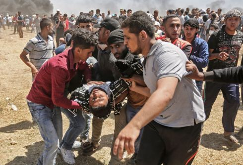 The death toll rose to 60 overnight and more than 2,200 Palestinians were also injured by gunfire or tear gas. Photograph: Mahmud Hams/AFP/Getty Images
