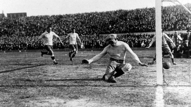 Uruguay's Pablo Dorado (out of picture) beats Argentina's goalkeeper Juan Botasso to score the first goal of the final after 12 minutes. Photo: Popperfoto/Getty Images
