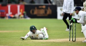 Imam ul-Haq of Pakistan avoids being run out during the fifth day of the international test cricket match between Ireland and Pakistan at Malahide. Photograph:  Charles McQuillan/Getty Images