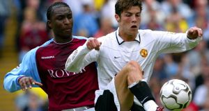 Jlloyd Samuel tussles with  Cristiano Ronaldo in his Aston Villa days. Photograph: Darren Staples/Reuters