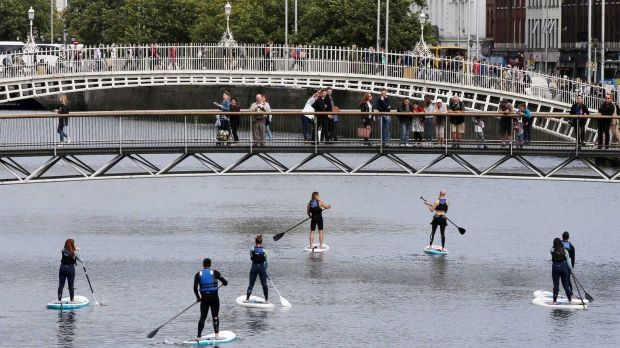 Stand-up paddle boarders on the River Liffey in Dublin. Photograph: Sam Boal/Rollingnews.ie