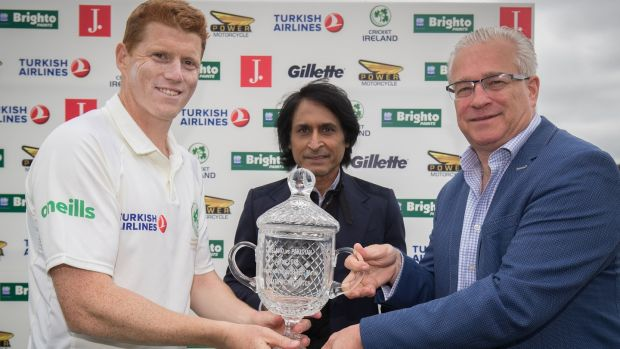 Kevin O'Brien is handed the man of the match award by Ross McCollum and Rameez Raja. Photograph: Oisin Keniry/Inpho