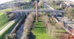 The Shanagarry Chimney in Dublin's Milltown is the last remaining structure of the Old Dublin Laundry. The Luas Green Line runs across the adjacent Nine Arches viaduct
