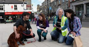 Jade Farrelly of Cavan Pro Choice and Emma Wallace of Alliance for Choice, Belfast speak to Joe Doherty and Jackie O'Neill (with Ruby the dog) about a Yes vote in Cavan town. Photograph: Lorraine Teevan