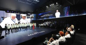The big reveal: all 21 finalists stand in front of the seven jury member for the San Pellegrino Young Chef global final