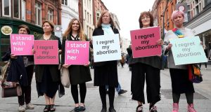 Women from the group Women Hurt gather on Grafton Street, Dublin, to call for a No vote ahead of the referendum on the Eighth Amendment. Photograph:  Brian Lawless/PA Wire