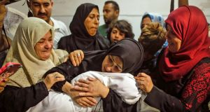 The body of  eight-month-old Leila al-Ghandour is held by her mother.  According to the Palestinian health ministry, the child  died of tear gas inhalation during clashes in East Gaza on Monday. Photograph: Mahmud Hams/AFP/Getty Images