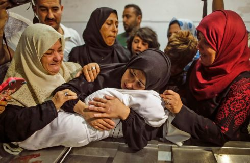 BABY DIES: Leila al-Ghandour, a Palestinian baby of eight months, is cradled by her mother at the morgue of al-Shifa hospital in Gaza City after dying of tear gas inhalation, according to the Palestinian health ministry, during  clashes in East Gaza on Monday. Photograph: Mahmud Hams/AFP/Getty Images