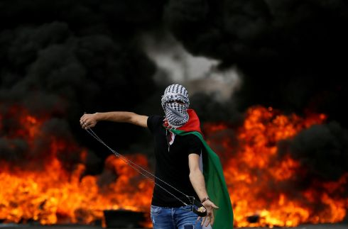 MARKING THE NAKBA:  A Palestinian prepares a slingshot during a protest marking the 70th anniversary of the Nakba, or loss of territory to Israel, near the Jewish settlement of Beit El, near Ramallah, in the occupied West Bank. Photograph: Mohamad Torokman/Reuters