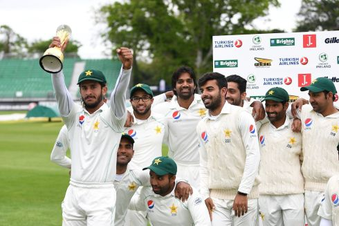 TIME TO CELEBRATE: Pakistan's Hasan Ali, with trophy, celebrates beating Ireland with his teammates after day five of the test match, at Malahide Cricket Club, Malahide, Dublin. Photograph: Clodagh Kilcoyne/Reuters
