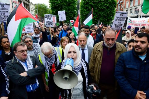PALESTINIAN SOLIDARITY: Fatin Al Tamimi, chairperson of  the Ireland Palestine Solidarity Campaign (IPSC), speaking  out on O'Connell Street in Dublin during a protest against Israel's killings of Palestinians in Gaza on Monday, and calling for the closure of the Irish Embassy in Israel. Sinn Féin councillor Mícheál Mac Donncha (with glasses), the Lord Mayor of Dublin, is at left. Photograph:  Cyril Byrne/The Irish Times