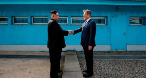 North Korea's leader Kim Jong-un shakes hands with South Korea's president Moon Jae-in at the military demarcation line that divides their countries last month.  Photograph: Korea Summit Press Pool/AFP/Getty Images