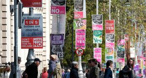 Referendum posters advocating Yes and No outside  Government Buildings in Dublin. Photograph: Getty Images