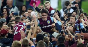 Jack Grealish is carried by Aston Villa players after their goalless draw with Middlesbrough, which secured a play-off final date at Wembley. Photograph: Clive Mason/Getty
