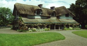 The Swiss Cottage outside Cahir, Co Tipperary, is a fairy-book cottage orné with a curving thatched roof, ideal for a family excursion.
