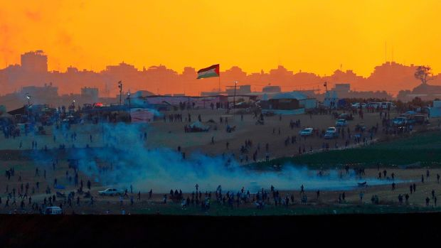 Tear gas fumes rise amid Palestinian protesters along the Gaza Strip border on Tuesday in a photograph taken from the southern Israeli kibbutz of Nahal Oz. Photograph: Jack Guez/AFP/Getty Images
