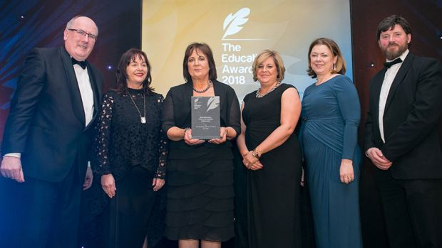 Jane O'Keefe, JC & Director of Supply Chain, NMCI/CIT presents Best Business & Third Level Institution Collaboration award to The Insurance Institute of Ireland & IT Sligo Team.