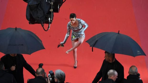 Shoe news: Kristen Stewart removes her Louboutins in Cannes. Photograph: Antonin Thuillier/AFP/Getty