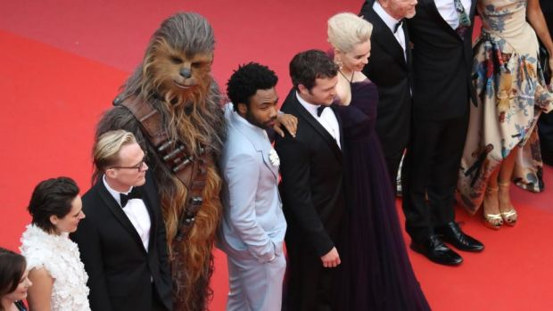 Solo: A Star Wars Story: Phoebe Waller-Bridge, Paul Bettany, Chewbacca, Donald Glover, Alden Ehrenreich, Emilia Clarke and Ron Howard at their film's Cannes premiere. Photograph: Valery Hache/AFP/Getty